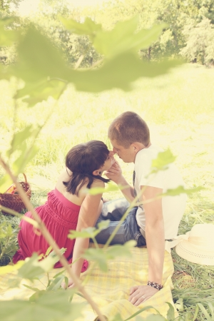 Romantic young couple resting on the Glade photo
