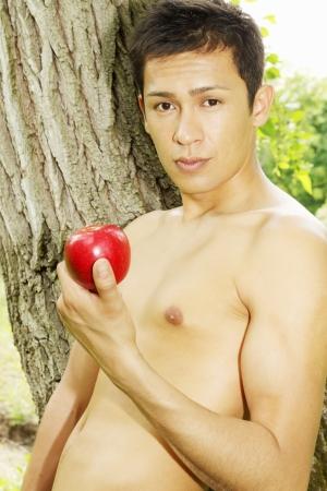 adam: Adam holds an apple in her hand