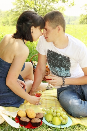 Young couple on a picnic with wine photo