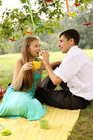 A man and woman make paper cranes Stock Photo - 15811772
