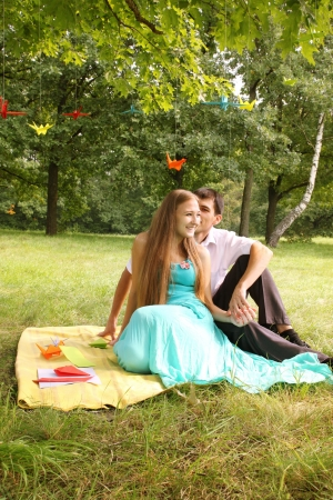 young couple having fun talking at a picnic photo