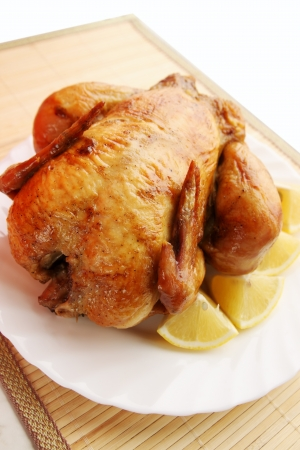 Ruddy roast chicken with lemon and spices Stock Photo - 16438119