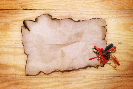 old paper with Christmas decorations on the wooden table photo