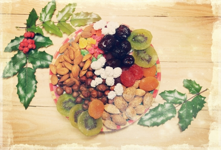 Still life with nuts and dried fruit in a Christmas style, vintage Stock Photo - 16666570