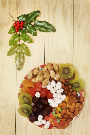 Still life with nuts and dried fruit in a Christmas style photo