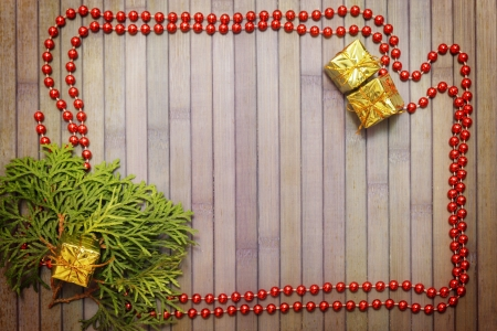 Christmas wooden background with garland and Thuja branch Stock Photo - 16666520