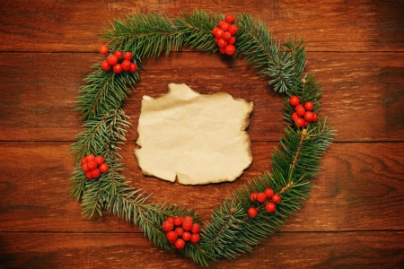 Christmas wreath of fir branches on the wooden background photo