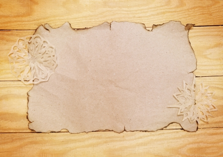 handwork: Old burnt empty paper  and decorative snowflakes handwork