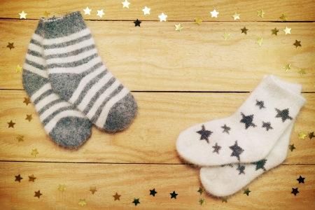 Christmas still life warm socks on a wooden board photo
