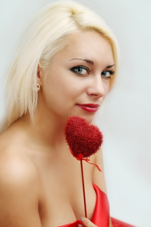 Valentines Day, Seductive woman holding a heart photo