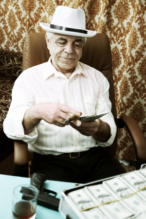Mafia man with a cigar and a pack of money Stock Photo - 16942358