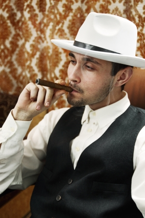 A young man in a hat with a cigar Stock Photo - 16942291