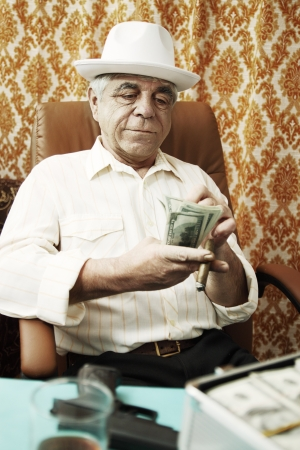 Mafia man with a cigar and a pack of money Archivio Fotografico