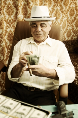 Mafia man with a cigar and a pack of money Stock Photo - 16942395