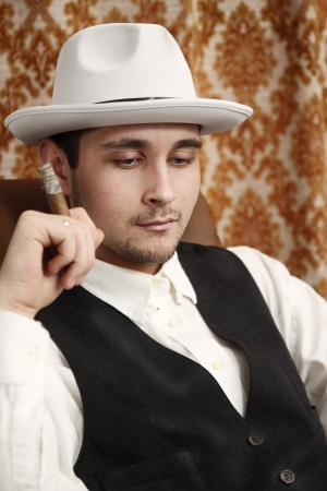 A pensive man in a hat with a cigar Stock Photo - 16942375