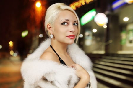 Portrait of a beautiful woman in a fur vest photo