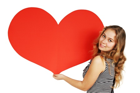 young woman holding a heart on Valentines Day photo