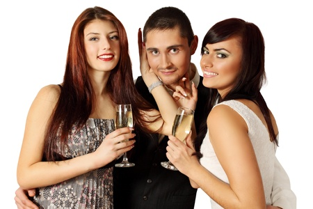 Man in the company of two women at a party Stock Photo - 17564869