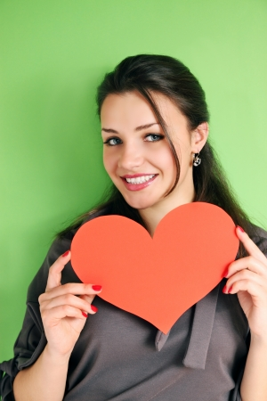 woman with a heart on a green background photo