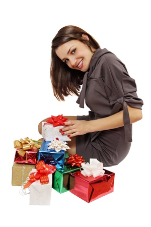 beautiful woman sits near a pile of gifts photo