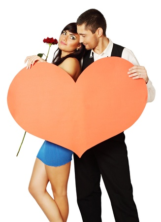 Young couple with a rose and a big heart Stock Photo - 17564945