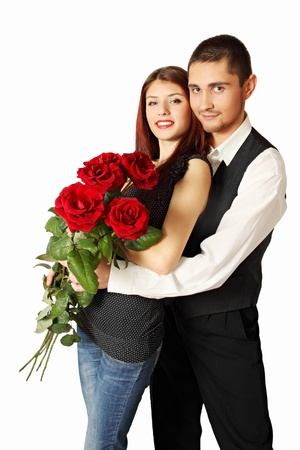 Young couple with bouquet a rose on a white background Stock Photo - 17564961