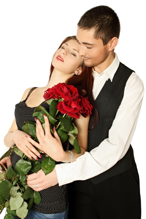 Young couple with bouquet a rose on a white background photo