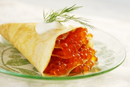 Ruddy pancake stuffed with red caviar, shrove Stock Photo - 17882672