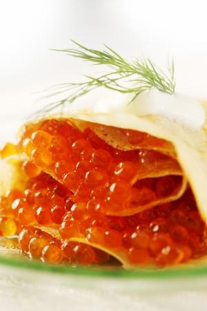 shrove: Ruddy pancake stuffed with red caviar, shrove Stock Photo