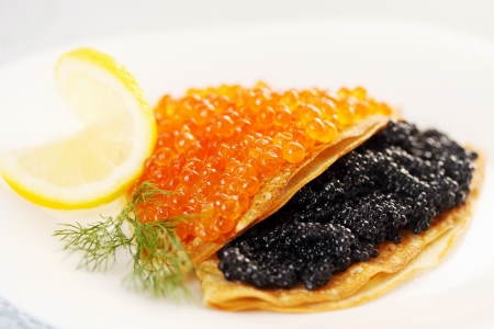 thin pancakes with red and black caviar Stock Photo - 17882703