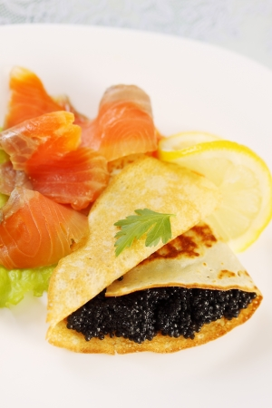 ruddy flapjack with caviar and smoked salmon photo