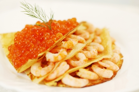 Ruddy pancake stuffed with red caviar, shrove Stock Photo - 17883087