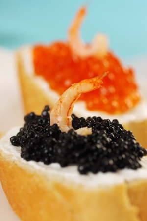 sandwich with red, black caviar and shrimp photo