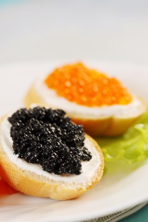 sandwich with red, black caviar and salmon photo
