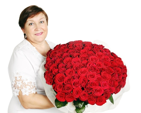Elderly woman holds a huge bouquet of red roses photo