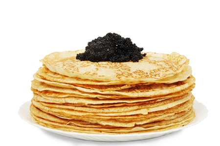 shrove tuesday: large pile of ruddy pancakes with caviar Stock Photo