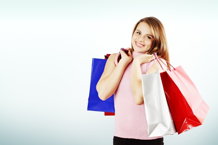 Happy woman and a lot of shopping bags, copy space photo