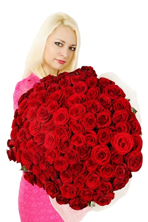 woman is holding a huge bouquet of red roses photo