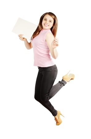 Jumping woman holding a piece of paper photo