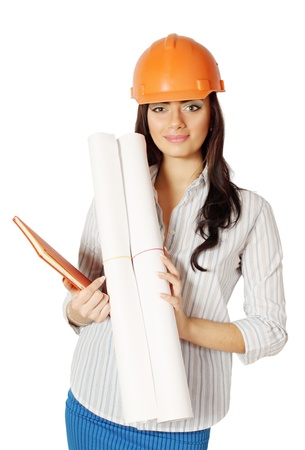 The woman in the construction helmet with working drawing