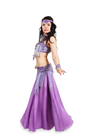 Beautiful woman dancing belly dance isolated on a white background photo