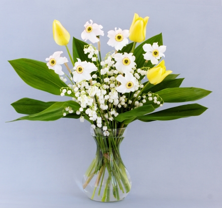 Spring bouquet of tulips, daffodils and lilies of the valley photo
