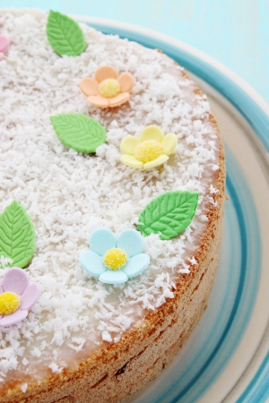 Sponge cake decorated with flowers and coconut
