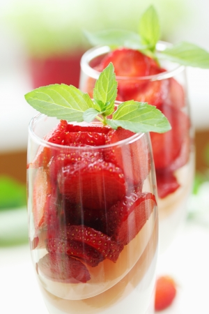 cream jelly with strawberries in a glass photo