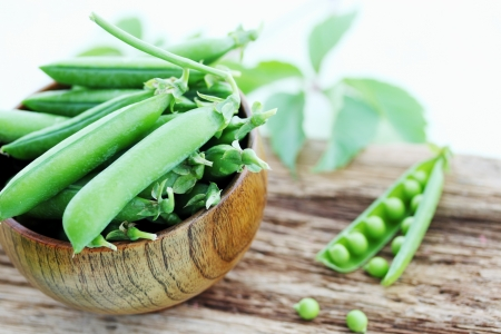 young fresh juicy pods of green peas photo