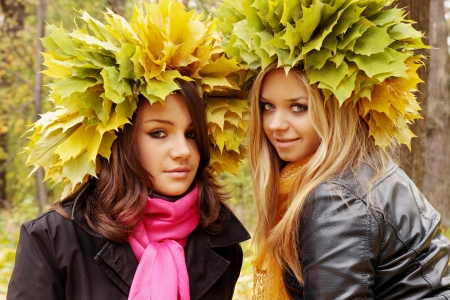 young womans wearing a wreath of autumn leaves photo