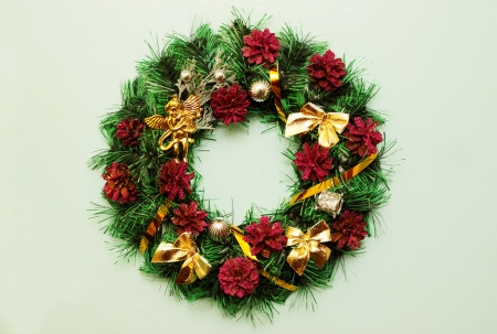 Christmas decorative wreath hanging on the door photo