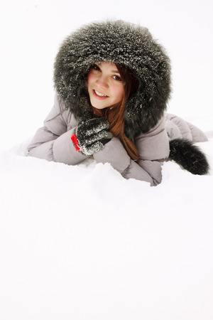 young woman in a fur hood in snow photo