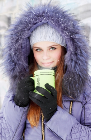 Young woman with a cup of hot drink Archivio Fotografico