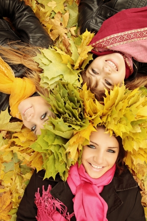 young womans wearing a wreath of autumn leaves Archivio Fotografico